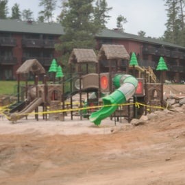 new playground and pool coming soon with lodge in background