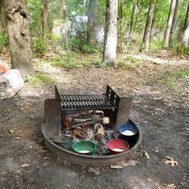 firepit with colorful citronella candle buckets
