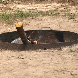 Previous campers left the fire smoldering. Don't forget to put it out before you leave
