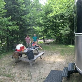 Notice the site is nice and level, notice the trees to the right of the Airstream which separate me from the neighbors, the site is long and narrow leading to the river front, the firepit is down closer to the river you can see it there.