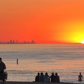 Sunset with Chicago easily seen across Lake Michigan from the beach.