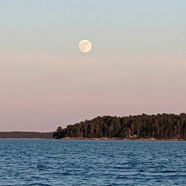 Summer solstice full moon view from eastern shore of cg