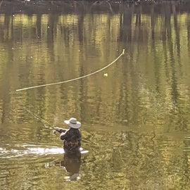 My husband fishing right off our camping lot.