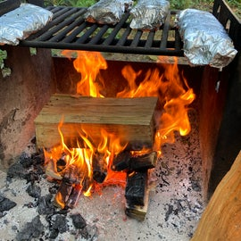 Solid fire pits for cooking