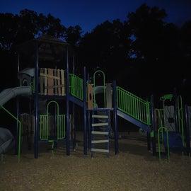 Playground photo taken at night.