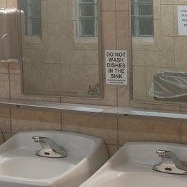 Bathrooms are nice tile surface with shelf for your items when at the mirror/sink.  Just keep in mind no dishes in the bathroom.