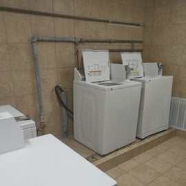 Laundry room has 2 washers and dryers