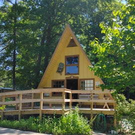 Nature Center A frame and next to it is a cabin as well.