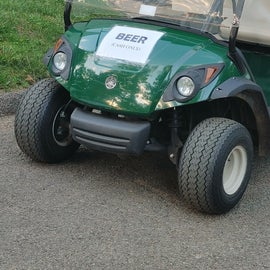 Beer golf cart for folks golfing most likely.