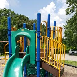 Playground photo of plastic slide and big toy.