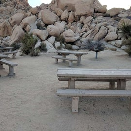 Group Site #7: Tables with a fire pit and grill.