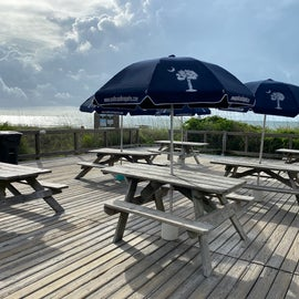 Nice ... umbrellas on the picnic tables near the pier!