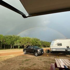 looking at a double rainbow over spot 411 (next to us) ❤️ path to river is directly to the left