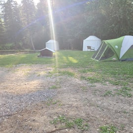 The tent area and two yurts along the pond