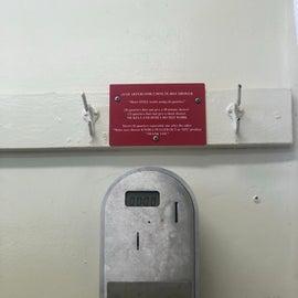 Machine with helpful sign