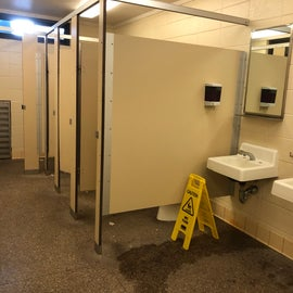 One bathroom with four stalls and three sinks was not adequate for 125 sites