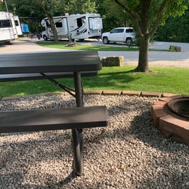 beautiful fire ring and well cared for lifetime picnic table