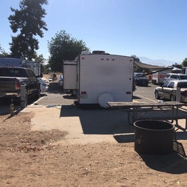 our literal parking lot RV space.  Had to park our truck in front of our trailer because there was no room elsewhere...