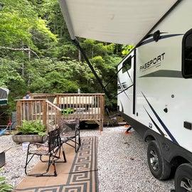 campsite showing deck over creek