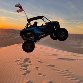 brother jumping a dune