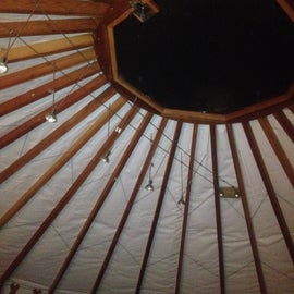 Yurt ceiling with pendant lamps and glass top