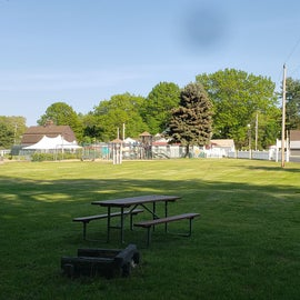 Open field, looking toward pool and entrance