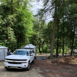 Fill station on your way in. Showers, bathrooms, pool and playground are a decent ways away from electric area. There is a porta potty back there