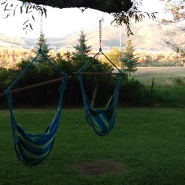 Swings overlooking the mountains beside a stream