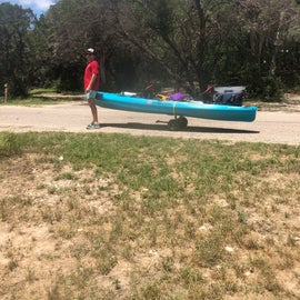 taking the kayak down to the river