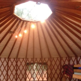 yurt with 2 sets of bunks, picnick table / benches, water (outside) & power!