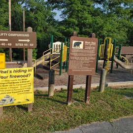 Clifty campground (Playground and information sign so you know which way to turn at the Y).
