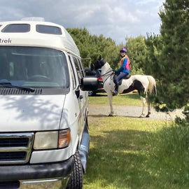 Parked our camper in the site next to the horse corrals.
