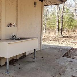 Dishwashing station at bathroom