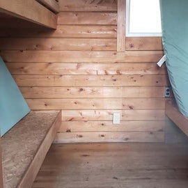 bunks and mattresses inside cabins