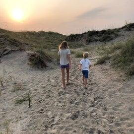 Sunrise walk through the dunes to the beach