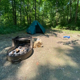 Campsite includes picnic table not shown in picture