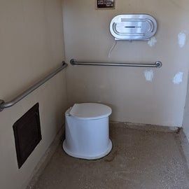 The pit toilet across from Site 24