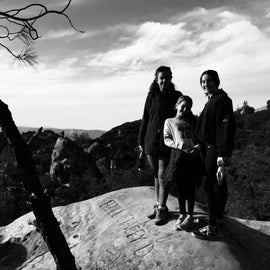 The family on top of one of the tallest rocks near Rock City