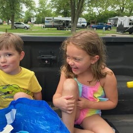 Playing in the back of the truck. Everything's fun when you camp.