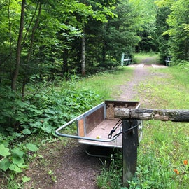 The bin is for the people staying at the cabin but keep walking past it and you will find the hiking trail