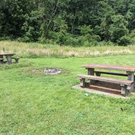concrete picnic tables and fire pits