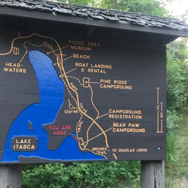 Info near the bike trail on the West side of Bear Paw camp.