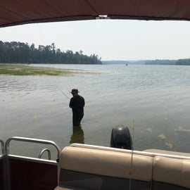 Rent a pontoon (or fishing boat) and explore the lake on your own.