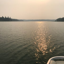 Sunset begins over the lake - Fires in Canada made the air super hazy in July 2021.