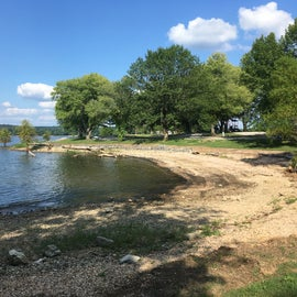 lil beach at edge of campground