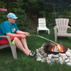 3rd grandson waiting for everyone to gather round the fire.