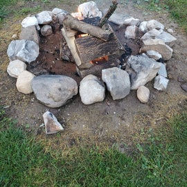 I love how they have the rocks lining the firepits, makes it so pretty!