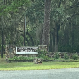 Upon entry, you'll find your well-groomed experience begins here with the Crooked River SP sign underneath a forest of Spanish Moss loaded Cypress trees