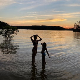 My little ladies silhouetted in front of a sinking sunset on the lake