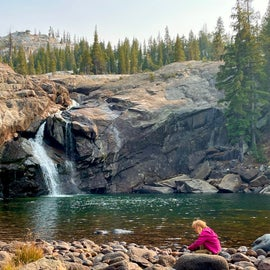 My daughter at the pool at the base of Tuolumne Falls, right next to camp.